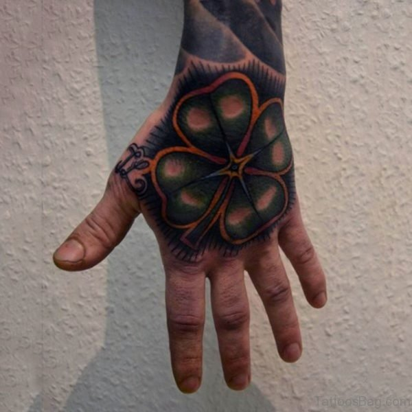 Amazing Four Leaf Clover Hand Tattoo On Man