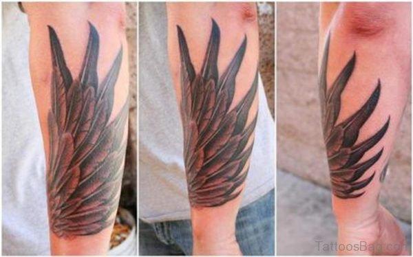 Amazing Grey Ink Wings Tattoo On Leg