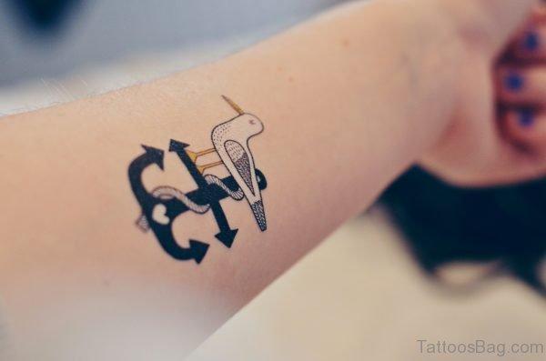 Anchor And Bird Tattoo On Arm