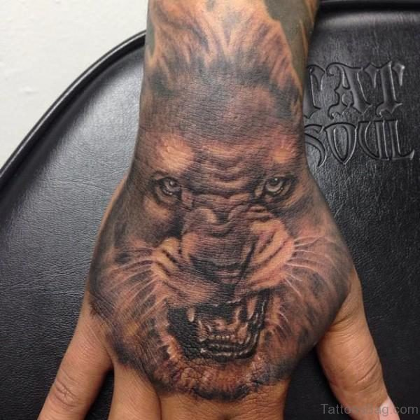 Angry Lion Tattoo On Hand