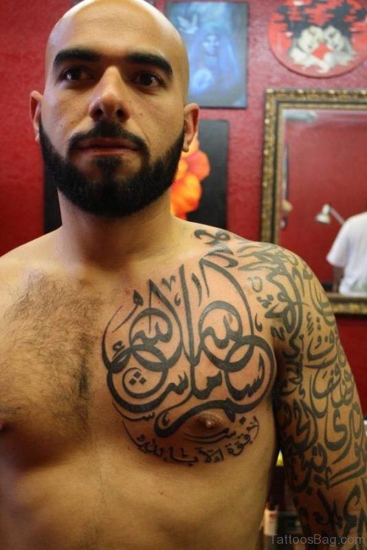 Arabic Long Tattoo On Chest Amd Shoulder