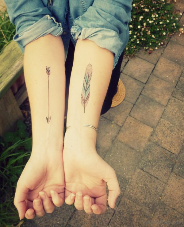 Arrow And Feather Tattoo On Arms