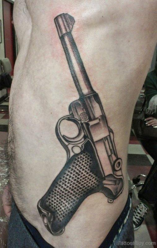 Attractive Gun Tattoo On Waist