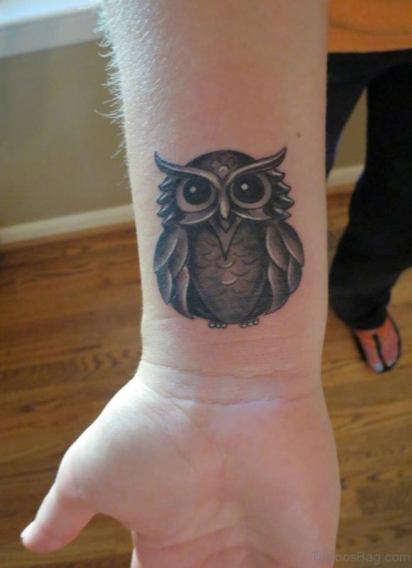 Attractive Owl Tattoo On Wrist
