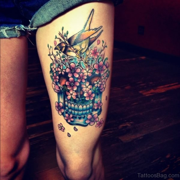 Attractive Skull Tattoo Design On Thigh