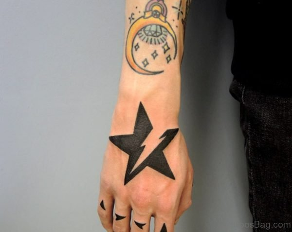 Attractive Star Tattoo On Hand