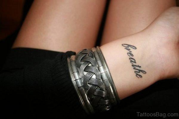 Attractive Word Tattoo On Wrist