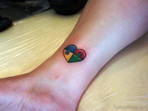 Autism Heart Shaped Tattoo On Wrist