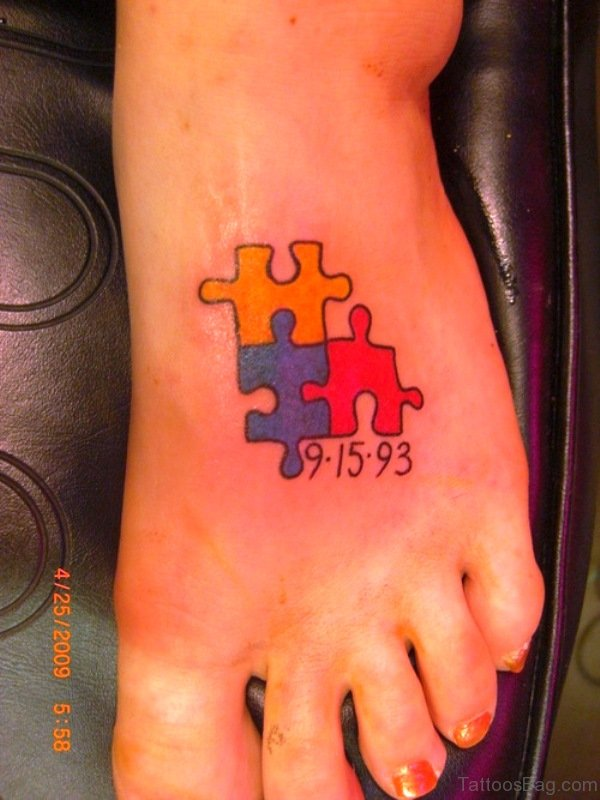 Autism Memorable Puzzle Tattoo On Foot