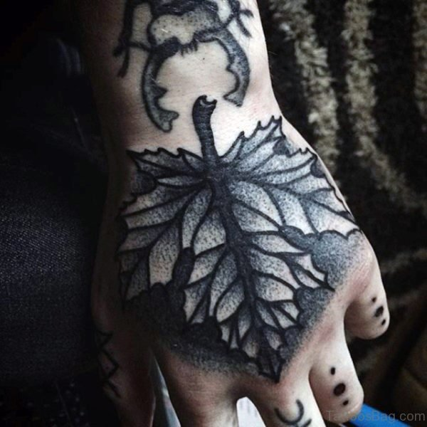 Autumn Leaf Hand Tattoo