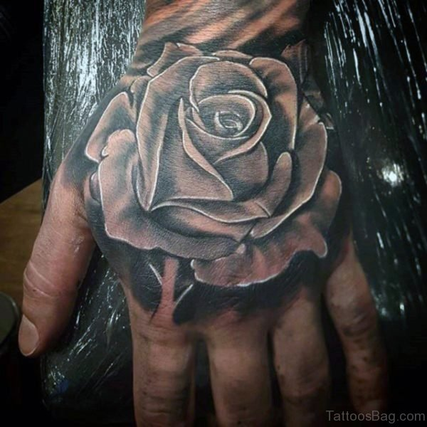 Awesome Black Rose Tattoo On Hand For Men