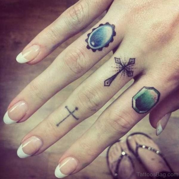 Awesome Cross Tattoo On Finger