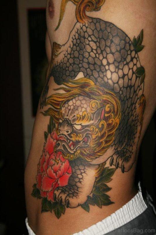 Awesome Dragon Tattoo Desine On Side Rib