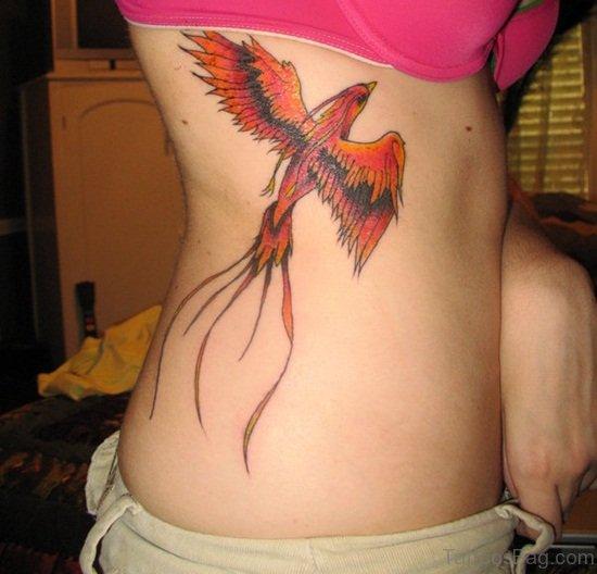 Awesome Phoenix Tattoo On Rib