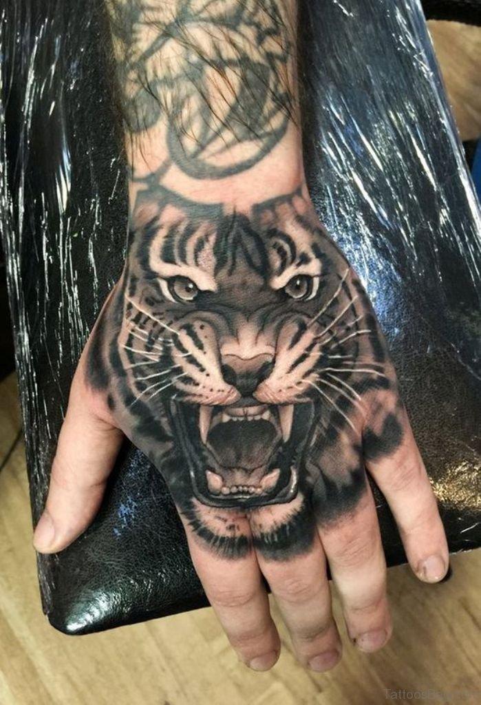 a17df582a4f6 62 Mind Blowing Tiger Tattoo On Hand