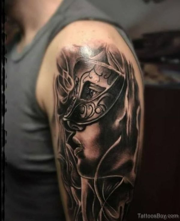 Awesome Venetian Mask Tattoo Design