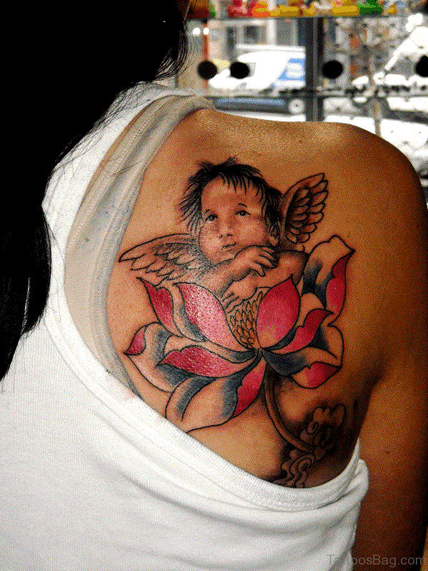Baby Angel With Flower Tattoo On Shoulder
