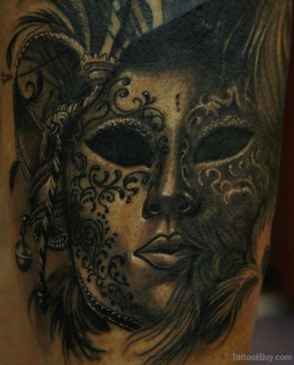 Balck Ink Venetian Mask Tattoo