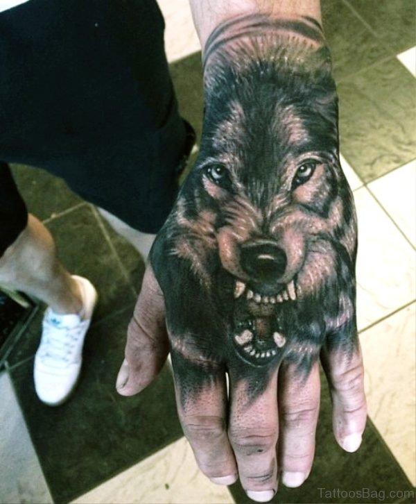 Beautiful Angry Alpha Wolf Tattoo On Hand