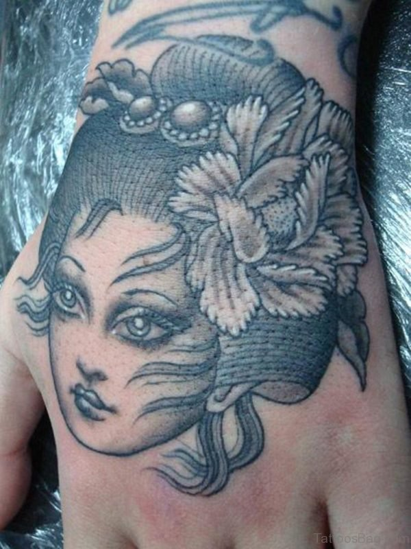 Beautiful Face Tattoo On Hand