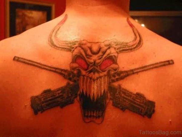 Big Teeth Bull Skull Tattoo With Gun On Back