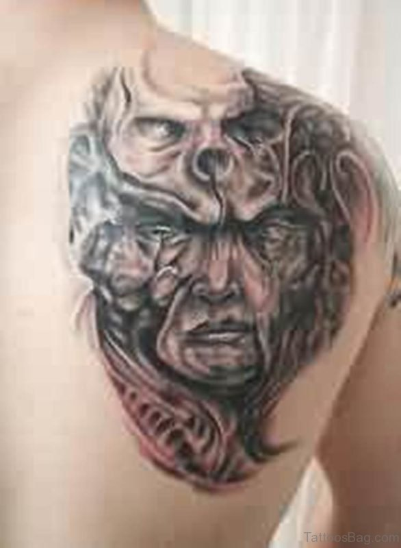 Biomechanical Alien Skull Tattoo On Back
