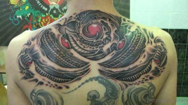 Biomechanical Alien Tattoo On Upperback