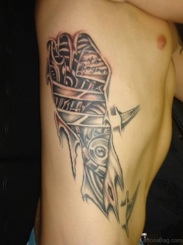 Biomechanical Tattoo Design On Rib