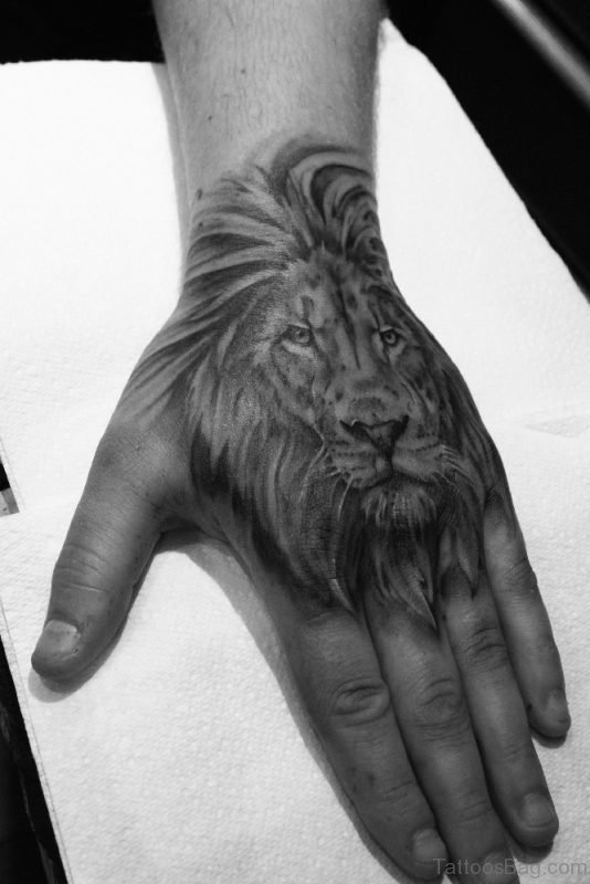 Black ANd White Lion Tattoo On Hand