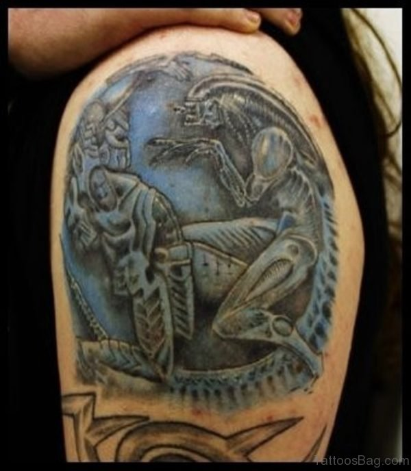 Black And Blue Alien Tattoo