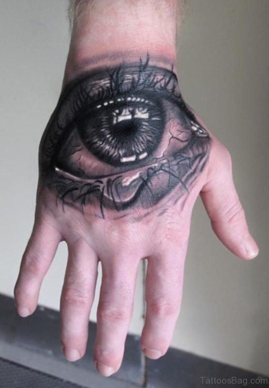 Black And Grey Crying Eye Tattoo On Hand