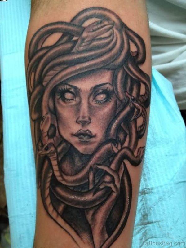 Black And Grey Ink Medusa Tattoo On Arm
