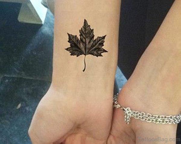 Black And Grey Maple Leaf Tattoo On Wrist