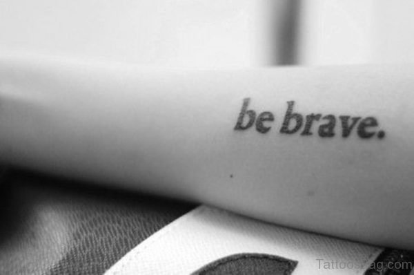 Black And White Brave Tattoo On Wrist