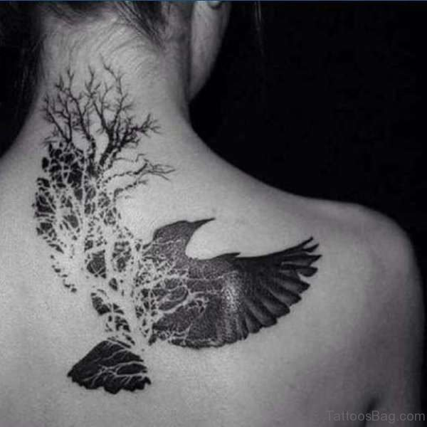 Black And White Flying Bird Shoulder Tattoo