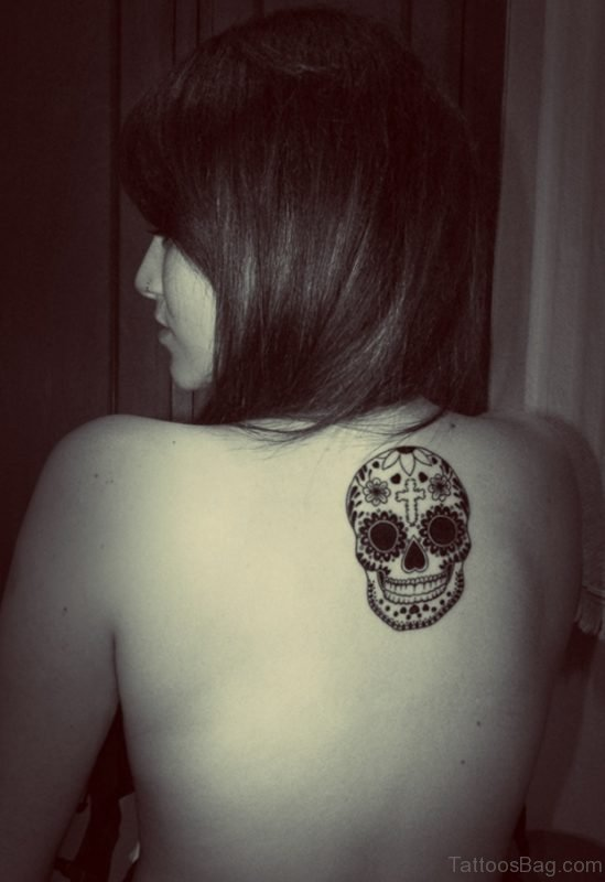 Black And White Mexican Skull Tattoo On Upper Back