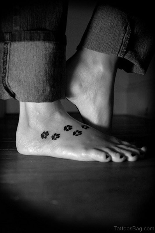 Black And White Paw Tattoo On Foot