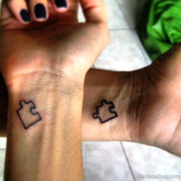 Black Autism Couple Tattoo On Wrist