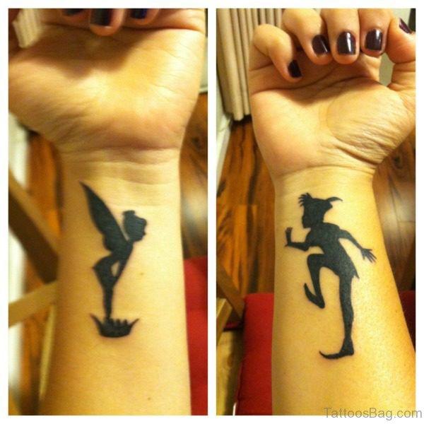 Black Colored Peter Pan Wrist Tattoo