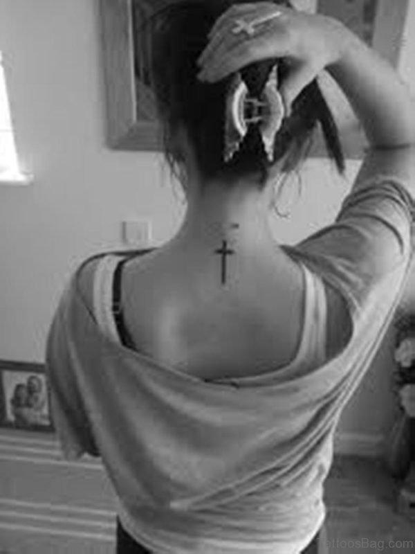 Black Cross Tattoo On Girl Nape Image