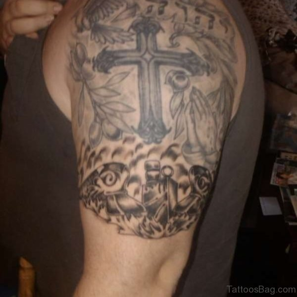 Black Cross Tattoo On Half Sleeve