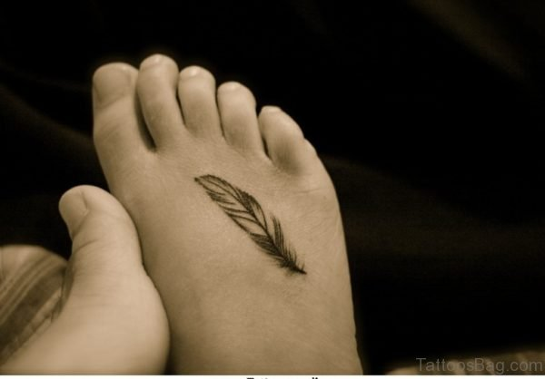 Black Feather Tattoo On Foot