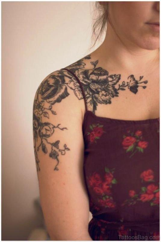 Black Flowers Tattoo On Shoulder