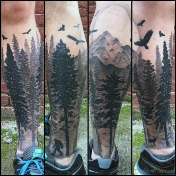 Black Flying Birds And Forest Tree Tattoo On Leg