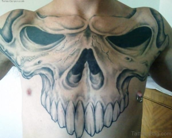 Black Giant Skull Tattoo On Chest