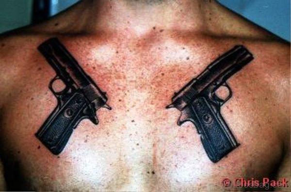 Black Guns Tattoo On Chest