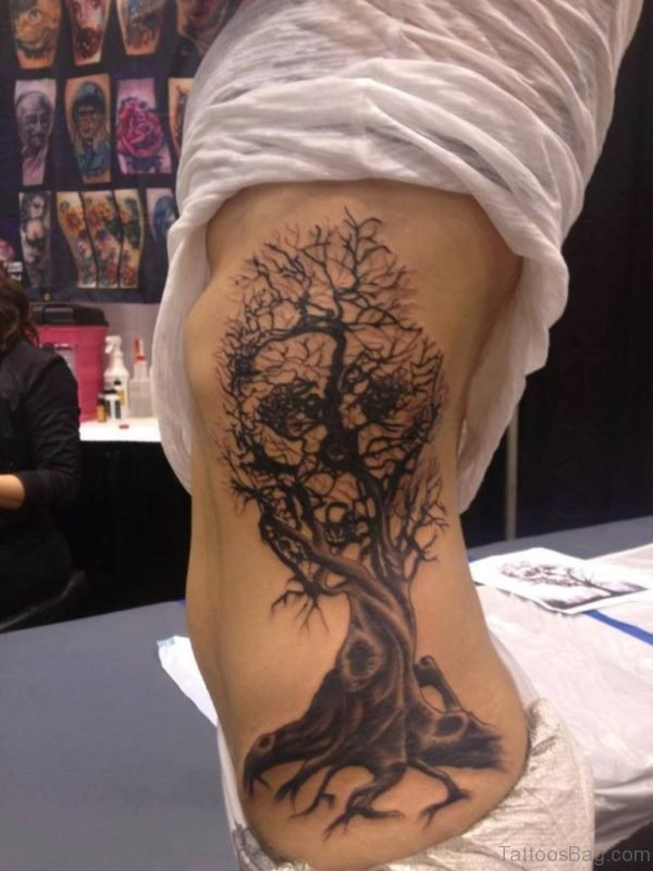 Black Halloween Tree With Skull Tattoo On Side Rib