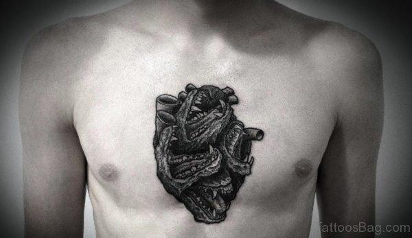 Black Human Heart Tattoo On Chest