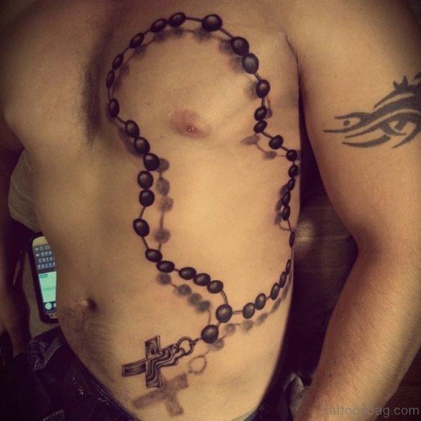 Black Ink 3D Rosary Cross Tattoo On Man Side Rib