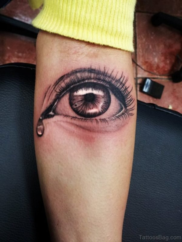 Black Ink Crying Eye Tattoo